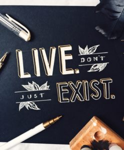 "art piece that says ""live, don't just exist"""